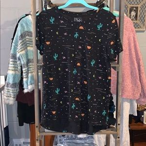 Short sleeved t-shirt with cactus and moons.